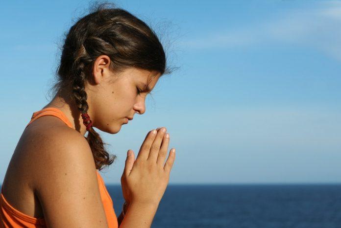 Lady in prayer